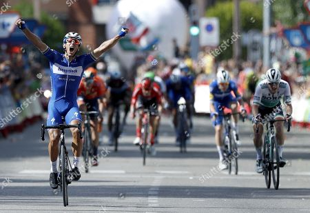 Stock Picture of Belgian rider of Deceuninck-Quick Step team Philippe Gilbert (L) celebrates his victory in the 17th stage of the Vuelta a Espana cycling race over 219.6km from Aranda de Duero to Guadalajara, Spain, 11 September 2019.