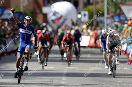 Belgian rider of Deceuninck-Quick Step team Philippe Gilbert (L) celebrates his victory in the 17th stage of the Vuelta a Espana cycling race over 219.6km from Aranda de Duero to Guadalajara, Spain, 11 September 2019.