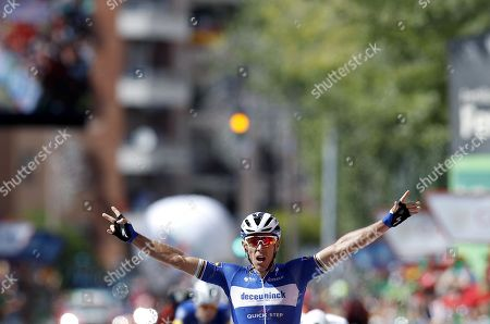 Belgian rider of Deceuninck-Quick Step team Philippe Gilbert celebrates his victory in the 17th stage of the Vuelta a Espana cycling race over 219.6km from Aranda de Duero to Guadalajara, Spain, 11 September 2019.