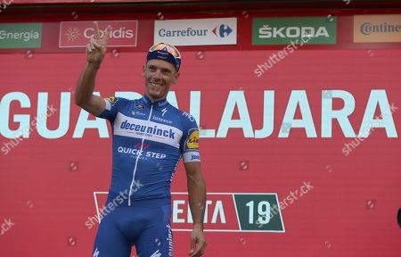 Belgian rider of Deceuninck-Quick Step team Philippe Gilbert celebrates on the podium his victory in the 17th stage of the Vuelta a Espana cycling race over 219.6km from Aranda de Duero to Guadalajara, Spain, 11 September 2019.