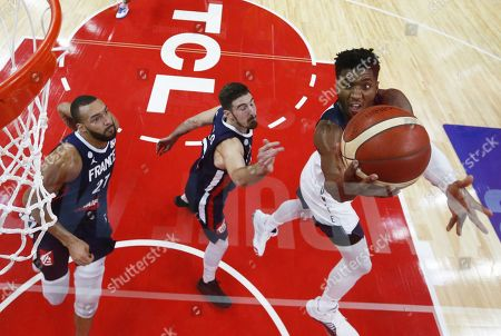 Donovan Mitchell (R) of the USA in action against French players Nando De Colo (C) and Rudy Gobert (L) during the FIBA Basketball World Cup 2019 quarter final match between the USA and France in Dongguan, China, 11 September 2019. France won 89-79.