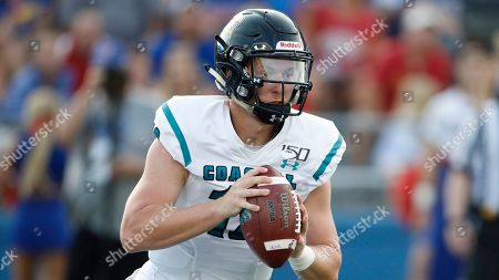 Stock Image of Ryan Lee. Coastal Carolina quarterback Grayson McCall during an NCAA football game against Kansas on in Lawrence, Kan