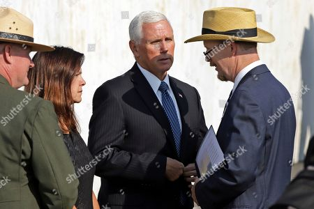 Stock Image of Vice President Mike Pence, center, and second lady Karen Pence, second from left, meet with President of Families of Flight 93, Gordon Felt, right, as they arrive for the September 11th Flight 93 Memorial Service at the Flight 93 National Memorial in Shanksville, Pa., the 18th anniversary of the attacks. Felt's brother Edward Felt was one of the 40 passenger and crew killed on Flight 93