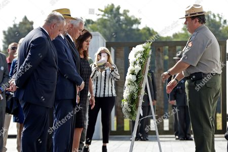 Stock Picture of Mike Pence, Karen Pence, Gordon Felt, David Bernhardt. Vice President Mike Pence, third from left, and second lady Karen Pence, fourth from left, are joined by President of Families of Flight 93, Gordon Felt, second from left, and Secretary of the Interior David Bernhardt, left, in placing a wreath at the Wall of Names following the September 11th Flight 93 Memorial Service at the Flight 93 National Memorial in Shanksville, Pa., the 18th anniversary of the attacks. Felt's brother Edward Felt was one of the 40 passenger and crew killed on Flight 93