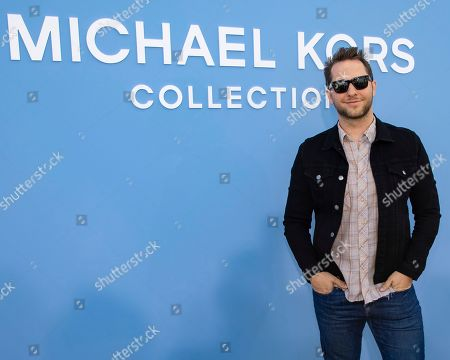 Derek Blasberg attends the Michael Kors runway show at Duggal Greenhouse during NYFW Spring/Summer 2020, in Brooklyn, New York