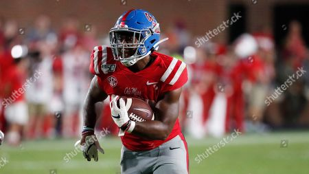 Mississippi running back Scottie Phillips (22) runs upfield against Arkansas during the second half of their NCAA college football game, in Oxford, Miss. Mississippi won 31-17