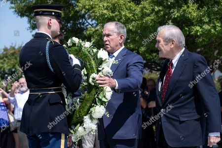 Former US President George W. Bush (C) and former US Secretary of Defense Donald Rumsfeld (R) participate in a wreath-laying ceremony to commemorate the 18th anniversary of the 9/11 terrorist attacks, at the Pentagon in Arlington, Virginia, USA, 11 September 2019.