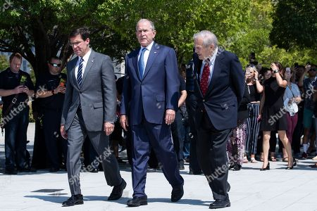 Stock Image of Former US President George W. Bush (C), former US Secretary of Defense Donald Rumsfeld (R) and US Secretary of Defense Mark Esper (L) arrive to participate in a wreath-laying ceremony to commemorate the 18th anniversary of the 9/11 terrorist attacks, at the Pentagon in Arlington, Virginia, USA, 11 September 2019.
