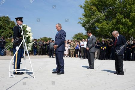 Stock Photo of Former US President George W. Bush (C), former US Secretary of Defense Donald Rumsfeld (R) and US Secretary of Defense Mark Esper (2-R) participate in a wreath-laying ceremony to commemorate the 18th anniversary of the 9/11 terrorist attacks, at the Pentagon in Arlington, Virginia, USA, 11 September 2019.