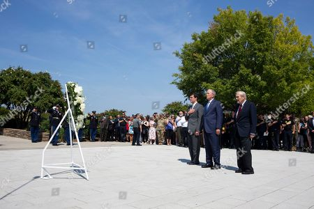 Former US President George W. Bush (C), former US Secretary of Defense Donald Rumsfeld (R) and US Secretary of Defense Mark Esper (L) participate in a wreath-laying ceremony to commemorate the 18th anniversary of the 9/11 terrorist attacks, at the Pentagon in Arlington, Virginia, USA, 11 September 2019.