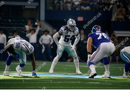 Dallas Cowboys' defensive end Joe Jackson, middle linebacker Jaylon Smith (54) and New York Giants offensive tackle Nate Solder (76) stand at the line of scrimmage during a NFL football game in Arlington, Texas