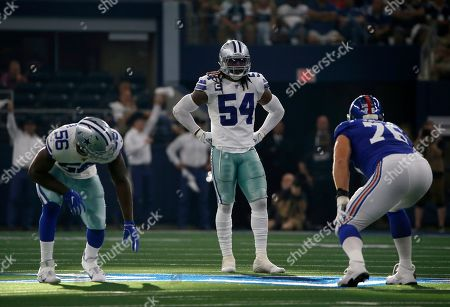 Stock Picture of Dallas Cowboys' defensive end Joe Jackson, middle linebacker Jaylon Smith (54) and New York Giants offensive tackle Nate Solder (76) stand at the line of scrimmage during a NFL football game in Arlington, Texas