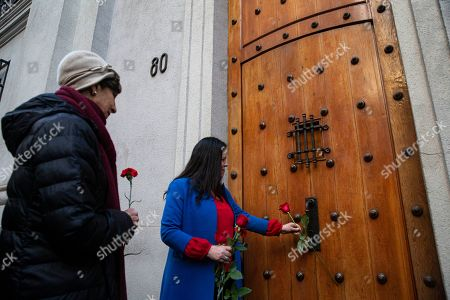 Stock Image of Maya Fernandez Allende, right, and Isabel Allende, granddaughter and daughter of Chile's late President Salvador Allende place flowers outside the eastern entrance of La Moneda presidential palace, on the anniversary of the 1973 military coup and Allende's subsequent death, in Santiago, Chile, . It was through this entrance that Allende's body was carried by soldiers and firefighters from the destroyed presidential palace 46 year ago during the coup that ousted the democratically elected leader and began the 17-year dictatorship of Gen. Augusto Pinochet