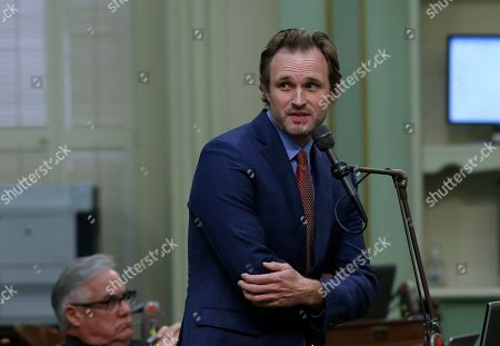 Assemblyman James Gallagher, R-Yuba City, urges lawmakers to reject a measure to give new wage and benefit protections at the so-called gig economy companies like Uber and Lyft, during the Assembly session in Sacramento, Calif., . The bill AB5, by Assemblywoman Lorenza Gonzalez, D-San Diego, was approved and now goes to the governor, who has said he supports it