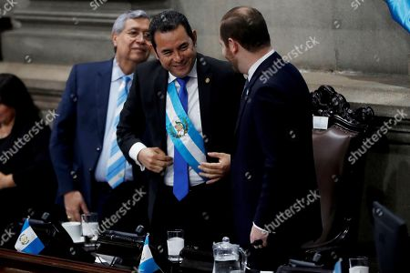 President of Guatemala, Jimmy Morales (C), Jafeth Cabrera (L), vice president of Guatemala, and Álvaro Arzu (R), president of the Guatemalan Congress, attend a solemn session for the country's Independence Day at the Congress in Guatemala City, Guatemala, 11 September 2019. Morales accused the media of being 'slaves' of the International Commission Against Impunity in Guatemala (CICIG), an entity sponsored by the United Nations to investigate and prosecute serious crime in Guatemala that concluded its work on 03 September after 12 years.