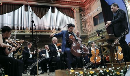 French cellist Gautier Capucon (C), accompanied by the Monte-Carlo Philharmonic Orchestra under the batton of Maxim Vengerov (R), performs Tchaikovsky's 'Variations on a Rococo Theme op. 33' on the stage of the Romanian Athenaeum concert hall during the George Enescu International Festival 2019, in Bucharest, Romania, 11 September 2019. The festival, held since 1958 every two years, is the biggest classical music festival held in Romania, in honor of Romanian composer and violinist George Enescu. The 24th edition of the George Enescu International Festival takes place between 31 August and 22 September 2019.
