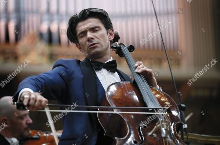 Stock Picture of French cellist Gautier Capucon (C), accompanied by the Monte-Carlo Philharmonic Orchestra performs Tchaikovsky's 'Variations on a Rococo Theme op. 33' on the stage of the Romanian Athenaeum concert hall during the George Enescu International Festival 2019, in Bucharest, Romania, 11 September 2019. The festival, held since 1958 every two years, is the biggest classical music festival held in Romania, in honor of Romanian composer and violinist George Enescu. The 24th edition of the George Enescu International Festival takes place between 31 August and 22 September 2019.