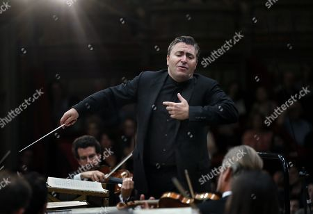 Stock Image of Russian-born Israeli violinist and conductor Maxim Vengerov conducts the Monte-Carlo Philharmonic Orchestra while they perform Tchaikovksy's Symphony no. 6 in B minor op. 74, 'Pathétique' on the stage of the Romanian Athenaeum concert hall during the George Enescu International Festival 2019, in Bucharest, Romania, 11 September 2019. The festival, held since 1958 every two years, is the biggest classical music festival held in Romania, in honor of Romanian composer and violinist George Enescu. The 24th edition of the George Enescu International Festival takes place between 31 August and 22 September 2019.