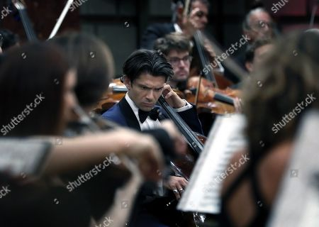 Stock Photo of French cellist Gautier Capucon (C), sings with the Monte-Carlo Philharmonic Orchestra as they performs Tchaikovksy's Symphony no. 6 in B minor op. 74, 'Pathétique' , under the batton of Maxim Vengerov, on the stage of the Romanian Athenaeum concert hall during the George Enescu International Festival 2019, in Bucharest, Romania, 11 September 2019. The festival, held since 1958 every two years, is the biggest classical music festival held in Romania, in honor of Romanian composer and violinist George Enescu. The 24th edition of the George Enescu International Festival takes place between 31 August and 22 September 2019.