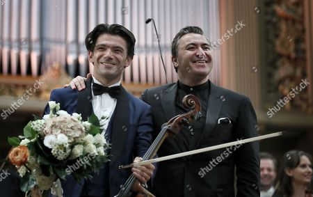 French cellist Gautier Capucon (L) and Russian-born Israeli violinist and conductor Maxim Vengerov (R)greet the audience after performong Tchaikovsky's 'Variations on a Rococo Theme op. 33' with Monte-Carlo Philharmonic Orchestra on the stage of the Romanian Athenaeum concert hall during the George Enescu International Festival 2019, in Bucharest, Romania, 11 September 2019. The festival, held since 1958 every two years, is the biggest classical music festival held in Romania, in honor of Romanian composer and violinist George Enescu. The 24th edition of the George Enescu International Festival takes place between 31 August and 22 September 2019.