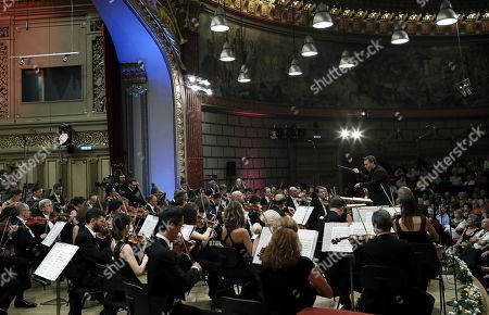 Russian-born Israeli violinist and conductor Maxim Vengerov (R) conducts the Monte-Carlo Philharmonic Orchestra while they perform Tchaikovksy's Symphony no. 6 in B minor op. 74, 'Pathétique' on the stage of the Romanian Athenaeum concert hall during the George Enescu International Festival 2019, in Bucharest, Romania, 11 September 2019. The festival, held since 1958 every two years, is the biggest classical music festival held in Romania, in honor of Romanian composer and violinist George Enescu. The 24th edition of the George Enescu International Festival takes place between 31 August and 22 September 2019.