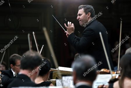 Russian-born Israeli violinist and conductor Maxim Vengerov conducts the Monte-Carlo Philharmonic Orchestra while they perform Tchaikovksy's Symphony no. 6 in B minor op. 74, 'Pathétique' on the stage of the Romanian Athenaeum concert hall during the George Enescu International Festival 2019, in Bucharest, Romania, 11 September 2019. The festival, held since 1958 every two years, is the biggest classical music festival held in Romania, in honor of Romanian composer and violinist George Enescu. The 24th edition of the George Enescu International Festival takes place between 31 August and 22 September 2019.