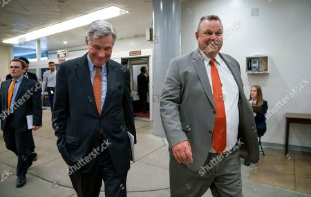 Stock Image of Sheldon Whitehouse, Jon Tester. Sen. Sheldon Whitehouse, D-R.I., left, and Sen. Jon Tester, D-Mont., arrive at the Senate for votes on pending nominations, at the Capitol in Washington