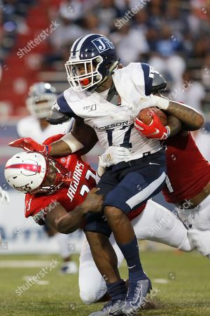 Left to right) South Alabama safety Keith Gallmon tackles Jacksonville State running back Jordan Johnson with South Alabama linebacker Chris Henderson during an NCAA football game on in Mobile, Ala