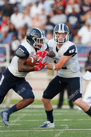 Left to right) Jacksonville State running back Jordan Johnson receives a pass from Jacksonville State quarterback Derrick Ponder while playing against South Alabama during an NCAA football game on in Mobile, Ala