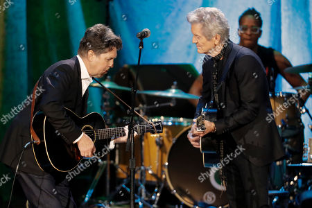 Joe Henry, Rodney Crowell. Joe Henry, left, and Rodney Crowell perform during the Americana Honors & Awards show, in Nashville, Tenn