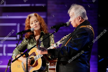 Bonnie Raitt, left, and John Prine perform during the Americana Honors & Awards show, in Nashville, Tenn
