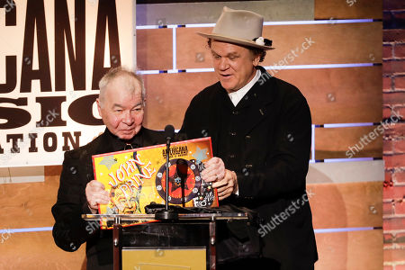 """John Prine accepts the Album of the Year award from actor John C. Reilly at the Americana Honors & Awards show, in Nashville, Tenn. Prine won the award for """"The Tree of Forgiveness"""