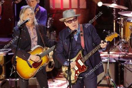 Stock Image of Elvis Costello, Jim Lauderdale. Elvis Costello, right, and Jim Lauderdale, left, perform during at the Americana Honors & Awards show, in Nashville, Tenn