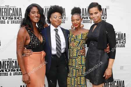 Our Native Daughters, from left, Leyla McCalla, Amythyst Kiah, Allison Russell and Rhiannon Giddens arrive at the Americana Honors & Awards show, in Nashville, Tenn