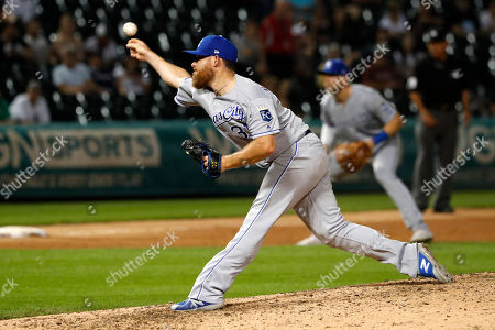 Stock Image of Kansas City Royals relief pitcher Ian Kennedy delivers during the ninth inning of the team's baseball game against the Chicago White Sox, in Chicago. The Royals won 8-6