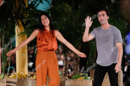 Designers Fernando Garcia and Laura Kim walk the runway after the Oscar de la Renta collection is modeled, in New York