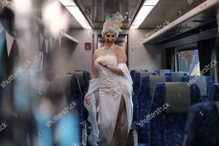 Drag queen Anita Wiglit poses for a photograph onboard the NSW TrainLink Silver City Stiletto train at Central station in Sydney, Australia, 12 September 2019. Drag queens and kings will travel to the outback NSW town of Broken Hill to attend the annual Broken Heel festival, paying homage to the iconic Australian film 'Priscilla, Queen of the Desert'.