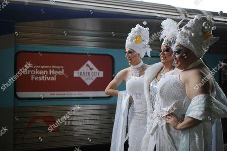 Drag queens Anita Wiglit, Maude Boate and Kita Mean pose for a photograph before boarding the NSW TrainLink Silver City Stiletto train at Central station in Sydney, Australia, 12 September 2019. Drag queens and kings will travel to the outback NSW town of Broken Hill to attend the annual Broken Heel festival, paying homage to the iconic Australian film 'Priscilla, Queen of the Desert'.