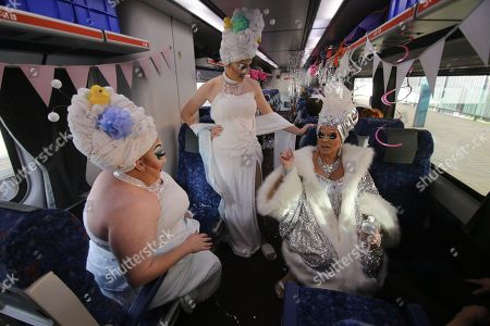 Drag queens Kita Mean, Anita Wiglit and Maude Boate aboard the NSW TrainLink Silver City Stiletto train at Central station in Sydney, Australia, 12 September 2019. Drag queens and kings will travel to the outback NSW town of Broken Hill to attend the annual Broken Heel festival, paying homage to the iconic Australian film 'Priscilla, Queen of the Desert'.