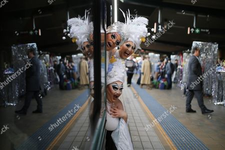 Drag queens (top left) Maude Boate, Anita Wiglit (top right) and Kita Mean pose for a photograph before boarding the NSW TrainLink Silver City Stiletto train at Central station in Sydney, Australia, 12 September 2019. Drag queens and kings will travel to the outback NSW town of Broken Hill to attend the annual Broken Heel festival, paying homage to the iconic Australian film 'Priscilla, Queen of the Desert'.