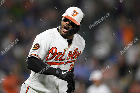 Baltimore Orioles' Jonathan Villar reacts towards the dugout after he hit a three-run home run during the seventh inning of a baseball game against the Los Angeles Dodgers, in Baltimore. Villar connected for the 6,106th homer in the majors this season. That topped the mark of 6,105 set in 2017. The Orioles won 7-3