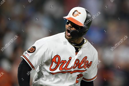 Stock Image of Baltimore Orioles' Jonathan Villar reacts towards the dugout after he hit a three-run home run during the seventh inning of the team's baseball game against the Los Angeles Dodgers, in Baltimore. Villar connected for the 6,106th homer in the majors this season. That topped the mark of 6,105 set in 2017. The Orioles won 7-3