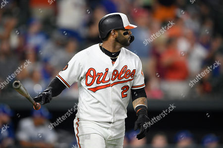 Stock Photo of Baltimore Orioles' Jonathan Villar watches his three-run home run during the seventh inning of the team's baseball game against the Los Angeles Dodgers, in Baltimore. Villar's homer was the 6,106th of the season in the majors, a new record. The Orioles won 7-3