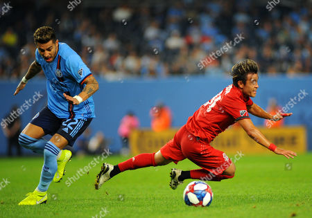Stock Image of NYCFC forward Ronald Matarrita (22) collides with Tubaso Endo (31) as they compete for the ball during the second half of an MLS soccer game against Toronto FC at Yankee Stadium in New York, NY