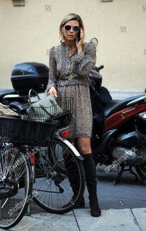 Martina Colombari takes a phone call after going shopping