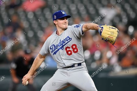 Los Angeles Dodgers starting pitcher Ross Stripling delivers a pitch during a baseball game against the Baltimore Orioles, in Baltimore