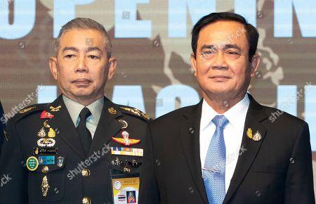 Apirat Kongsompong, Prayuth Chan-ocha. Thai army chief Gen. Apirat Kongsompong, left, and Thailand's Prime Minister Prayuth Chan-ocha, pose during a group photo session at the 11th Indo-Pacific Armies Chiefs Conference and 43rd Indo-Pacific Armies Management Seminar in Bangkok, Thailand