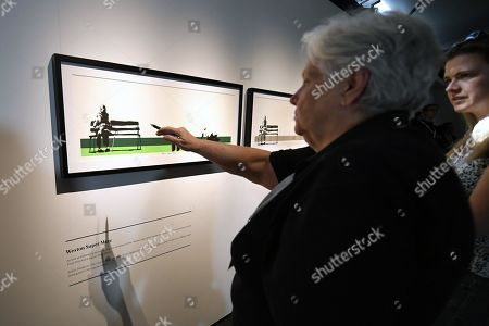 A visitor points at an art work by Banksy during a media preview of The Art Of Banksy at Moore Park's Entertainment Quarter in Sydney, Australia, 12 September 2019. The Art Of Banksy, the world's largest touring collection of Banksy's works, will open in Sydney on 13 September and is curated by Banksy's former manager and photographer Steve Lazarides.