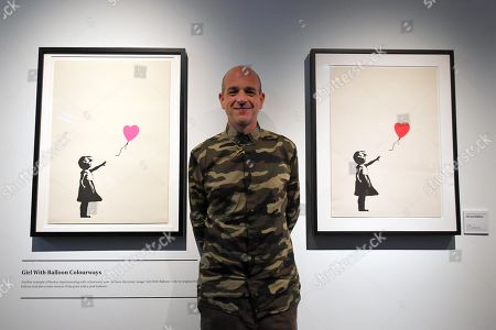 Stock Photo of Banksy's former manager and photographer Steve Lazarides poses for a photograph during a media preview of The Art Of Banksy at Moore Park's Entertainment Quarter in Sydney, Australia, 12 September 2019. The Art Of Banksy, the world's largest touring collection of Banksy's works, will open in Sydney on 13 September and is curated by Banksy's former manager and photographer Steve Lazarides.