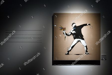 Stock Image of An art work by Banksy is displayed during a media preview of The Art Of Banksy at Moore Park's Entertainment Quarter in Sydney, Australia, 12 September 2019. The Art Of Banksy, the world's largest touring collection of Banksy's works, will open in Sydney on 13 September and is curated by Banksy's former manager and photographer Steve Lazarides.